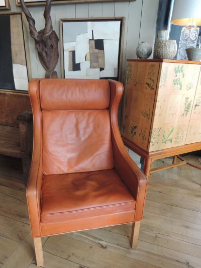 ORANGE LEATHER HIGH-BACKREST EAR CHAIR BY BORGE MOGENSEN CA. 1960