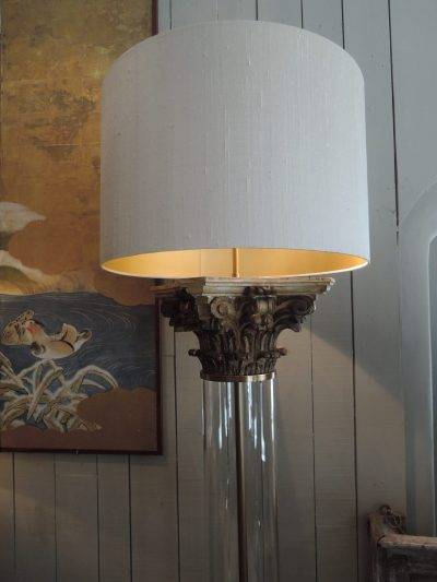 PAIR OF FLOORLAMPS WITH GLASS TUBE AND GILT WOOD CAPITALS