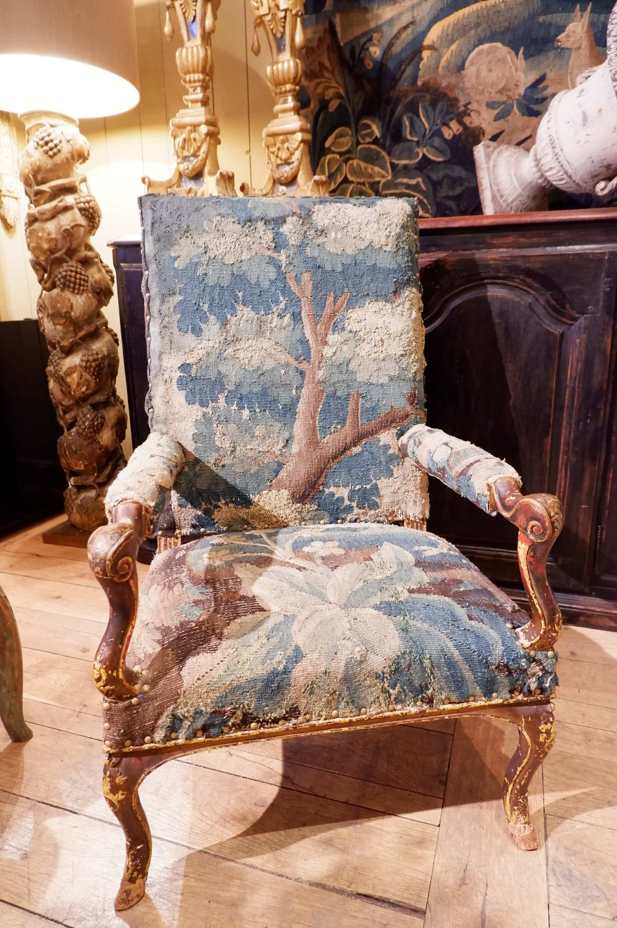 """French Regency period armchair in walnut covered with """"greenery""""  tapestry ca. 1700"""