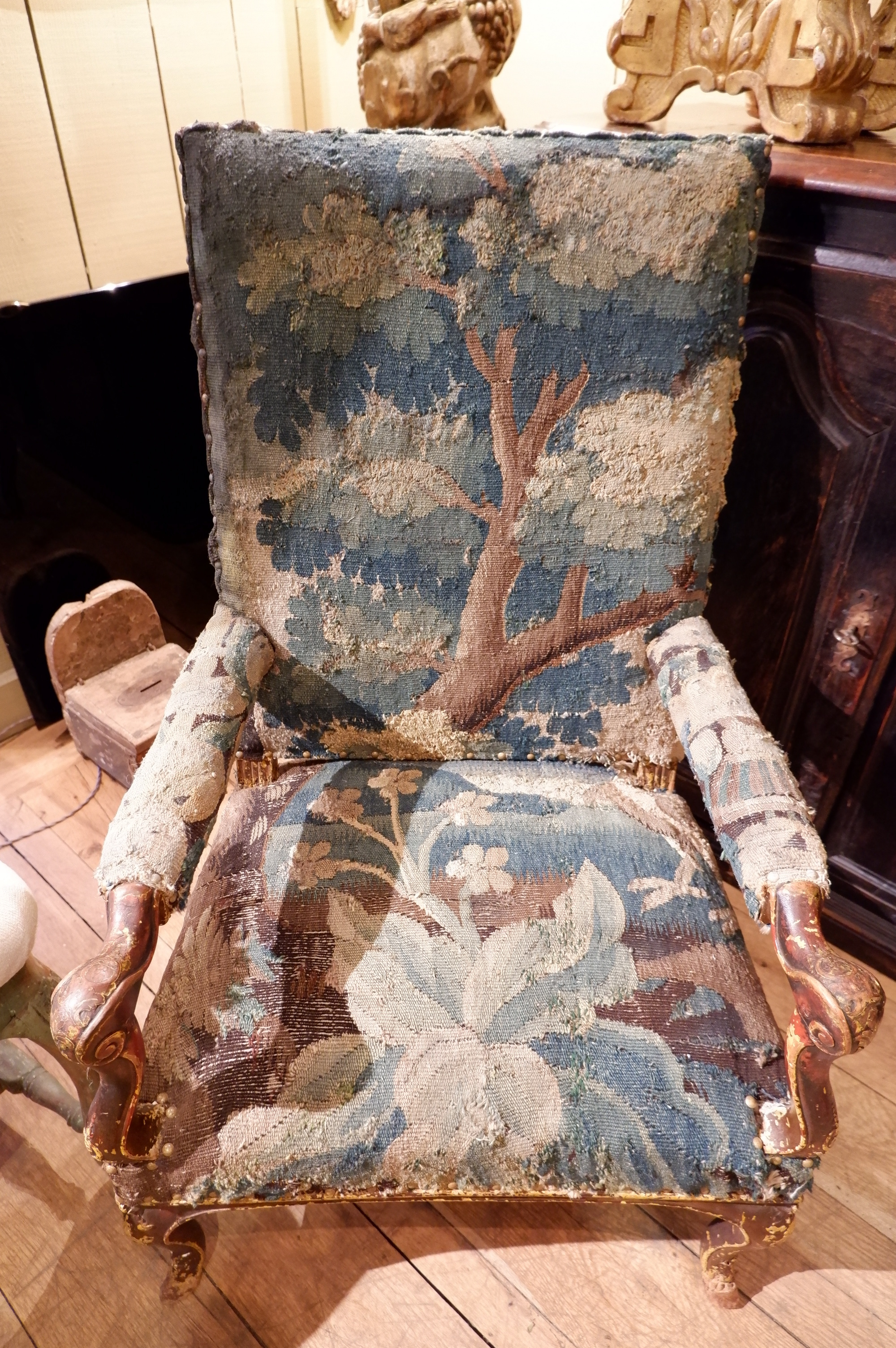 "French Regency period armchair in walnut covered with ""greenery""  tapestry ca. 1700"