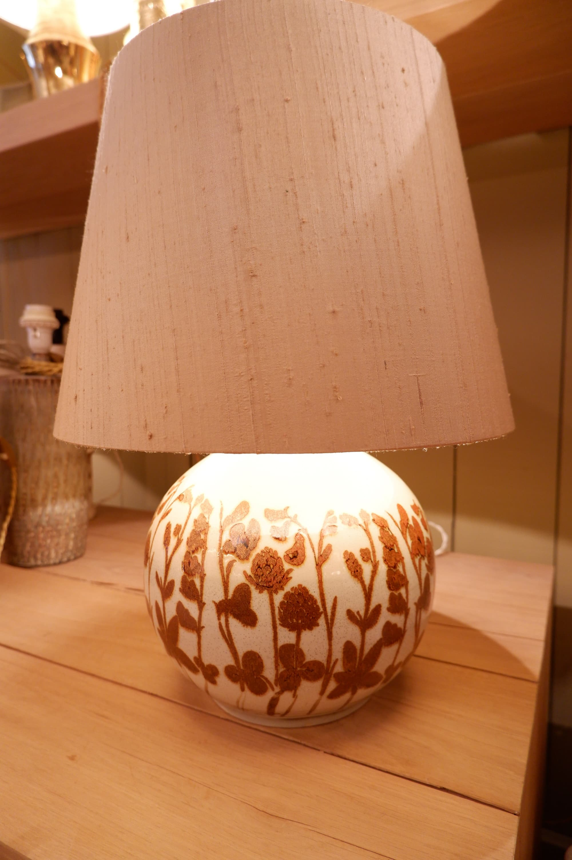 A ceramic ball shaped table lamp with flowers decor, signed by CARL HARRY STAHLANE Ca.1970