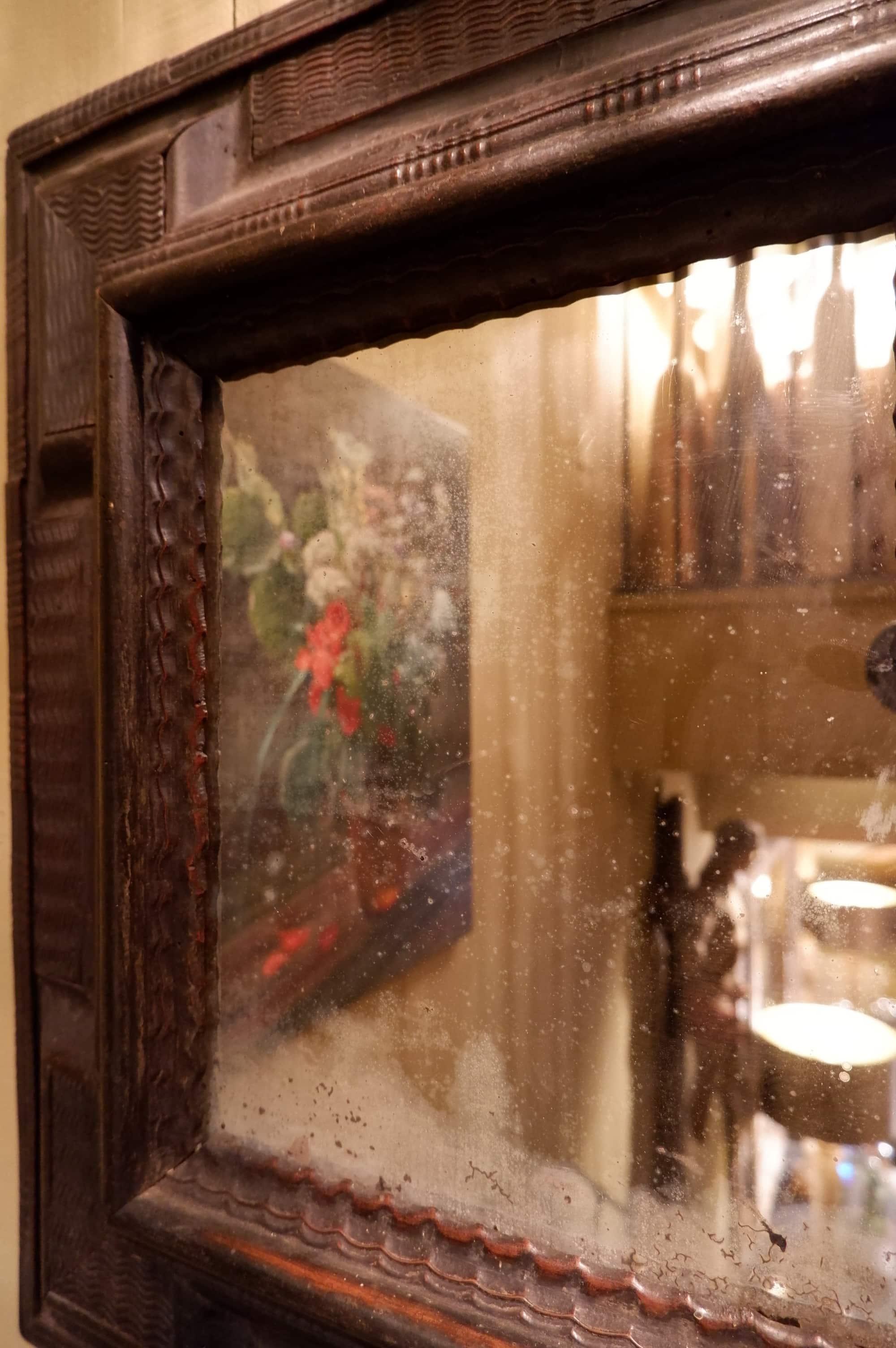 Miroir hollandais au mercure et cadre en bois guilloché ebonisé ca.1700