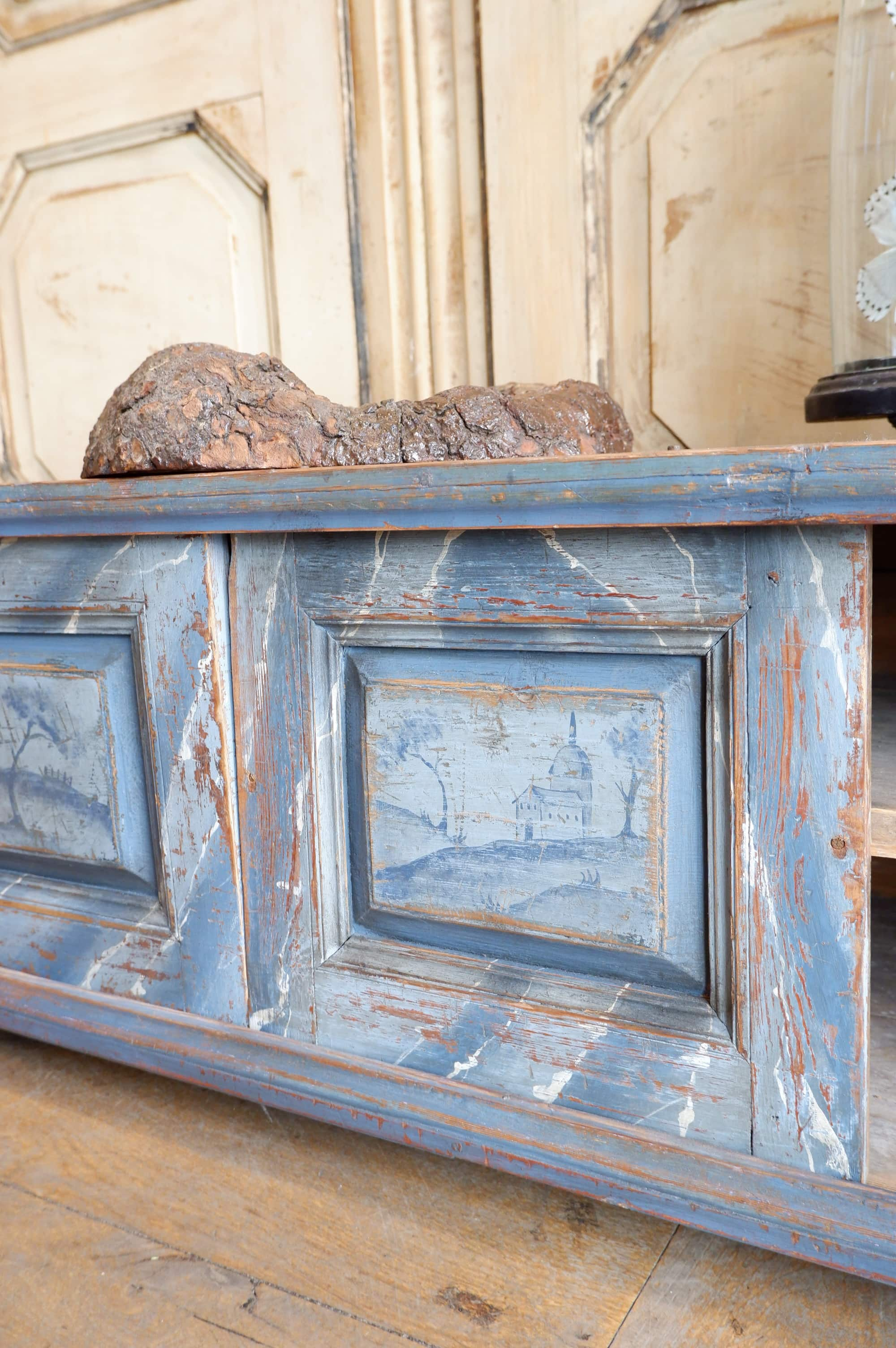Low painted cabinet with grey blue landscape decoration ca.1800
