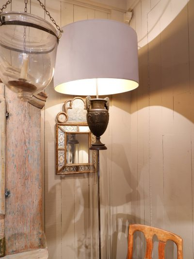 Large pair of floorlamps with bronze urns mounted over glass tube + silk shades