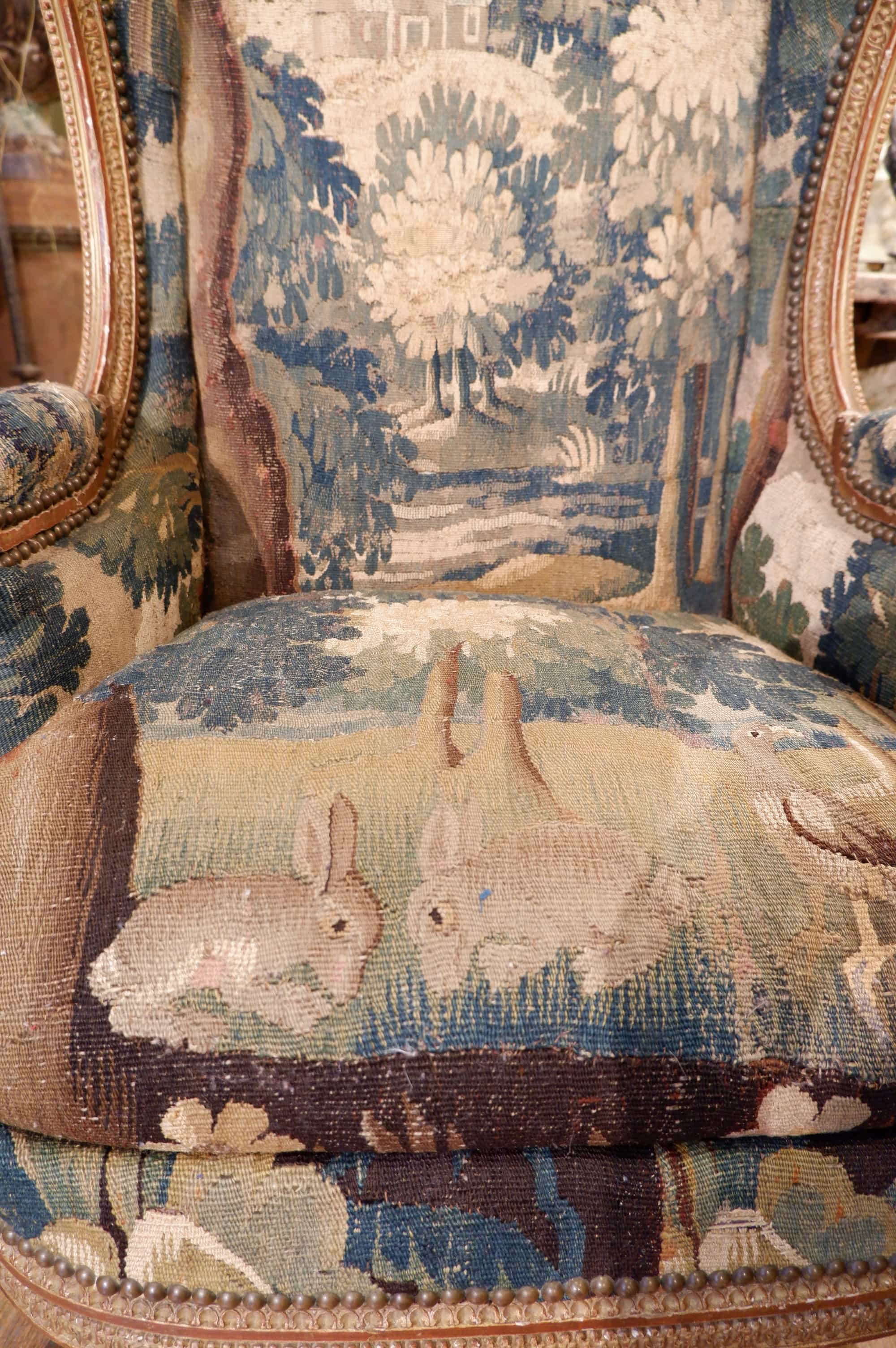 Louis XVI carved wooden wing chair covered with an Aubusson tapestry ca.1790